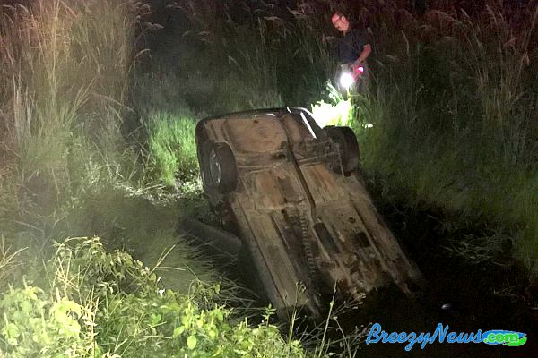 Vehicle Submerged in Water After Crash - BreezyNews com
